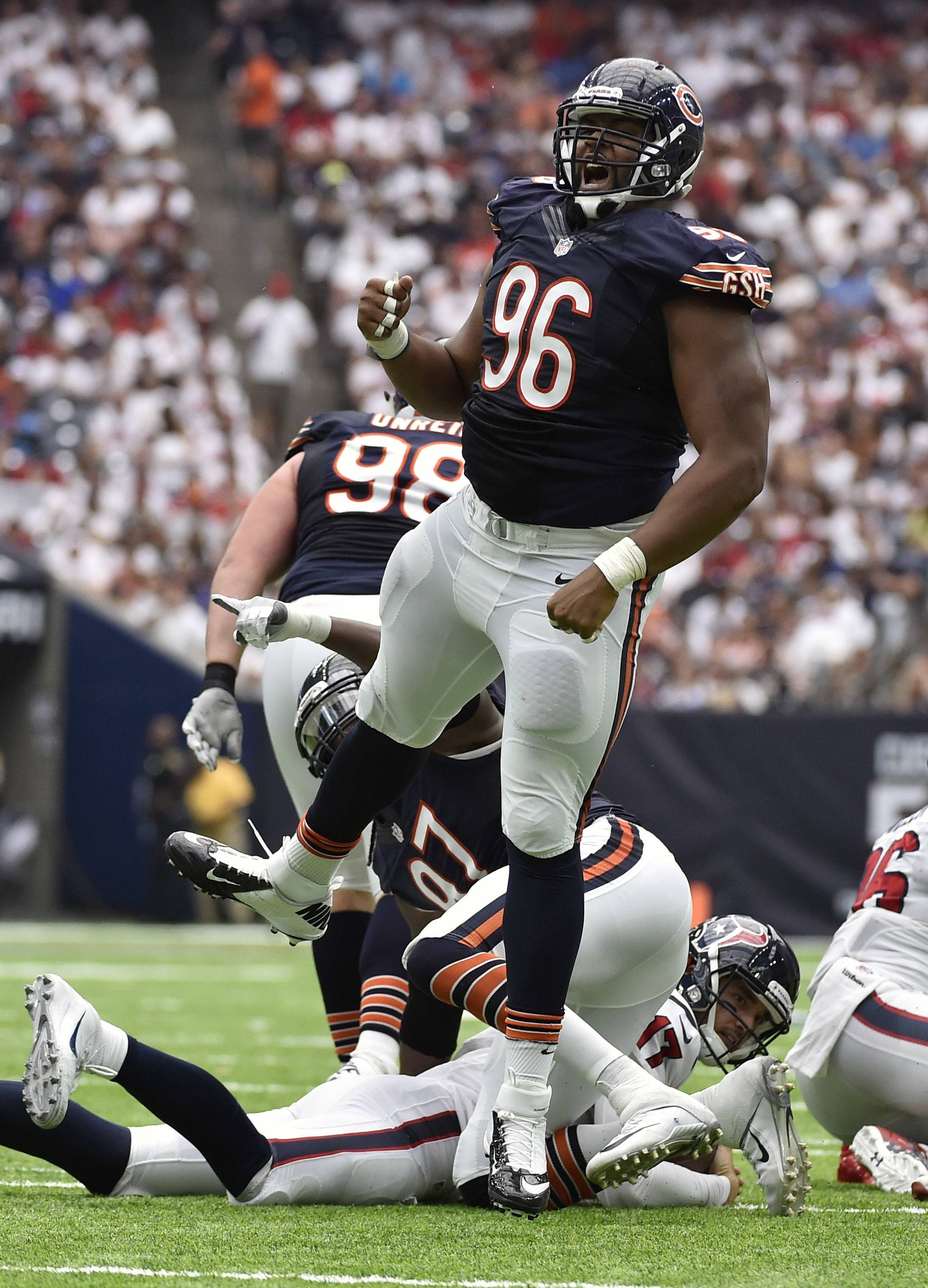 Bears defensive end Akiem Hicks celebrates a sack in last year's game against the Texans in Houston.
