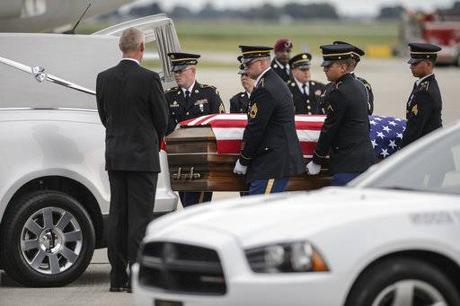 An army ceremonial unit carries Sgt. Jonathon Hunter casket to a hearse at the Columbus Municipal Airport in Columbus, Ind., Tuesday, Aug. 22, 2017. Hunter and 25-year-old Spec. Christopher Harris of Jackson Springs, N.C.,, were killed during an Aug. 2 attack on a NATO convoy. Both were with the 82nd Airborne Division at Fort Bragg, N.C. Hunter's funeral is set for Saturday at Columbus East High School. (Mike Wolanin/The Republic via AP)