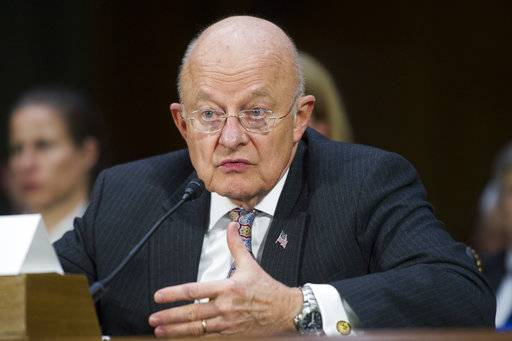 FILE - In this Jan. 10, 2017 file photo, then-National Intelligence Director James Clapper testifies on Capitol Hill in Washington. President Donald Trump and Clapper, the former national intelligence chief, are trading verbal barbs that started after Clapper questioned Trump's fitness to be in the Oval Office. (AP Photo/Cliff Owen, File)