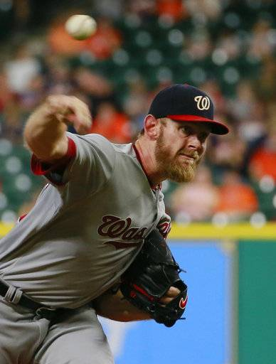Washington Nationals' Stephen Strasburg delivers a pitch against the Houston Astros during the first inning of a baseball game Thursday, Aug. 24, 2017, in Houston. (AP Photo/Richard Carson)