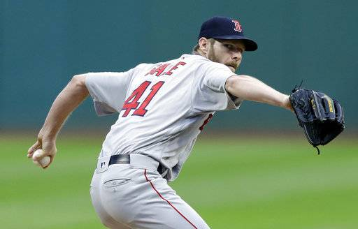 Boston Red Sox starting pitcher Chris Sale delivers in the first inning of a baseball game against the Cleveland Indians, Thursday, Aug. 24, 2017, in Cleveland. (AP Photo/Tony Dejak)