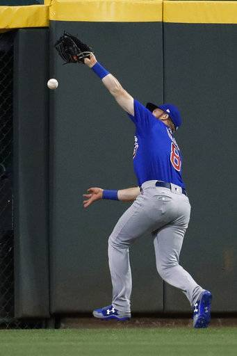 Chicago Cubs center fielder Ian Happ misses a go-ahead two-run ground-rule double by Cincinnati Reds' Jose Peraza off relief pitcher Pedro Strop during the eighth inning of a baseball game, Thursday, Aug. 24, 2017, in Cincinnati. The Reds won 4-2. (AP Photo/John Minchillo)