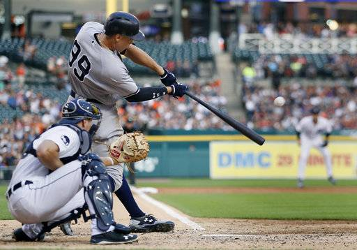 New York Yankees' Aaron Judge hits an RBI double against the Detroit Tigers during the third inning of a baseball game Wednesday, Aug. 23, 2017, in Detroit. (AP Photo/Duane Burleson)