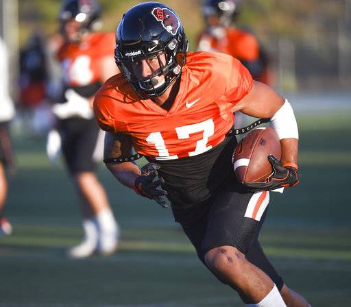 In this Aug. 4, 2017, photo freshman wide receiver Isaiah Hodgins participates in a scrimmage at Summit High School in Bend, Ore. True freshman receiver Hodgins looks to start on Saturday, Aug. 26, when Oregon State opens the season at Colorado State. A four-star recruit, Hodgins came to Corvallis early from the San Francisco Bay Area. (Amanda Loman/Albany Democrat-Herald via AP)
