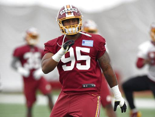 FILE - In this May 13, 2017, file photo, Washington Redskins defensive lineman Jonathan Allen warms up during an NFL football rookie minicamp in Ashburn, Va. It's not a coincidence that the Washington Redskins used their first two draft picks on players out of Alabama. Allen and linebacker Ryan Anderson should be immediate impact players in the NFL because of their pro-style preparation in college. (AP Photo/Nick Wass, File)