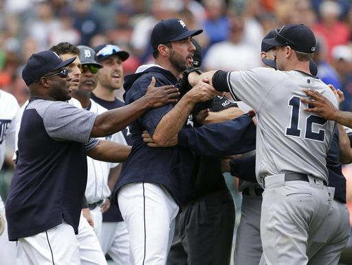 Detroit Tigers hitting coach Lloyd McClendon, left, tries to pull Justin Verlander, center, away from New York Yankees' Chase Headley during the second bench-clearing of the baseball game, in the seventh inning Thursday, Aug. 24, 2017, in Detroit. The Tigers defeated the Yankees 10-6. (AP Photo/Duane Burleson)