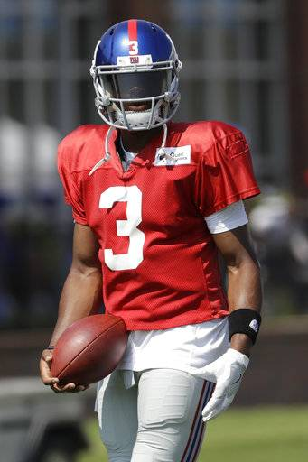 In a photo taken Thursday, Aug. 3, 2017, New York Giants quarterback Geno Smith works out during NFL football training camp in East Rutherford, N.J. Smith will face his former team, the New York Jets, when they play each other in a pre-season game Saturday, Aug. 26. (AP Photo/Julio Cortez)