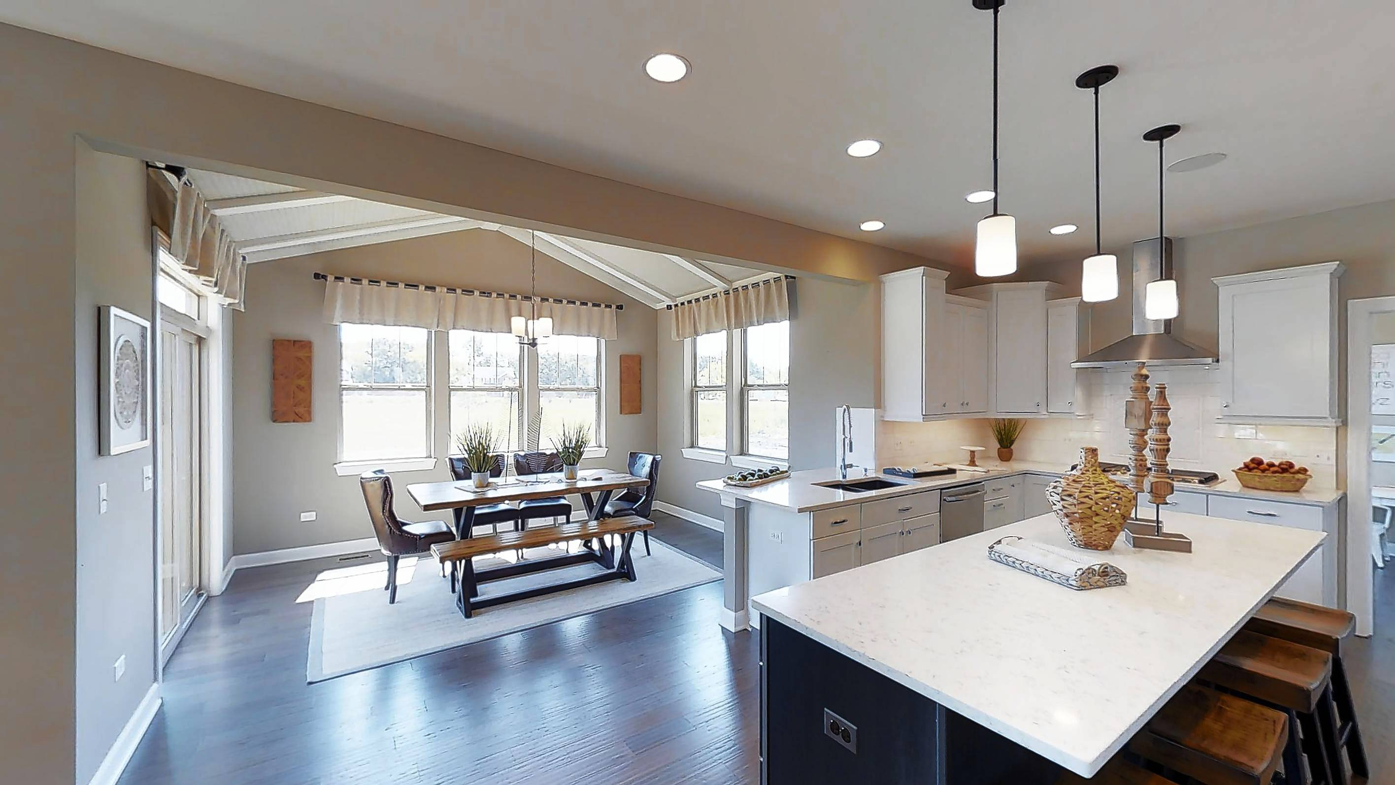 The model home showcases an open plan and a modern rustic interior design that fits in with the rural atmosphere of Hawthorn Woods.