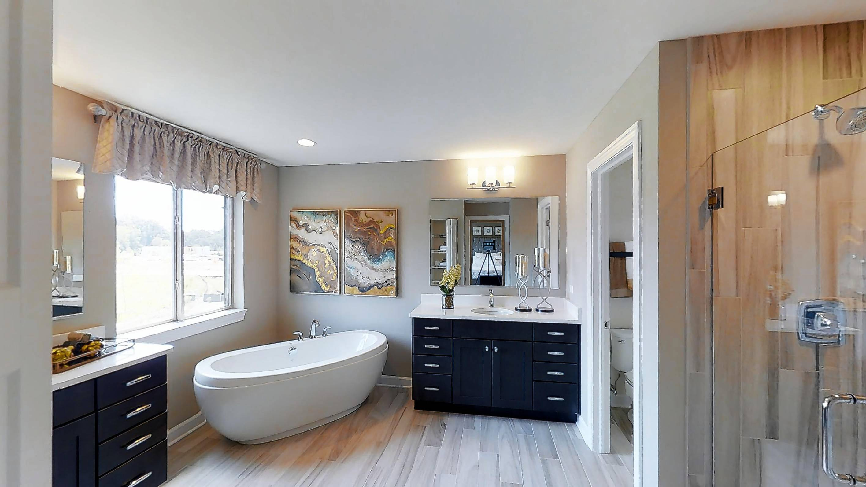 The master suite is an oasis of calm with a private luxury bath featuring a separate shower and corner soaking tub.