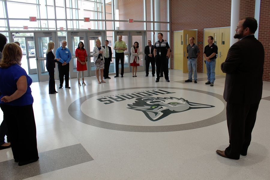 Thomas Middle School Principal Brian Kaye leads Arlington Heights Mayor Tom Hayes and other leaders on a tour of his newly expanded school, beginning in the new main entrance area.