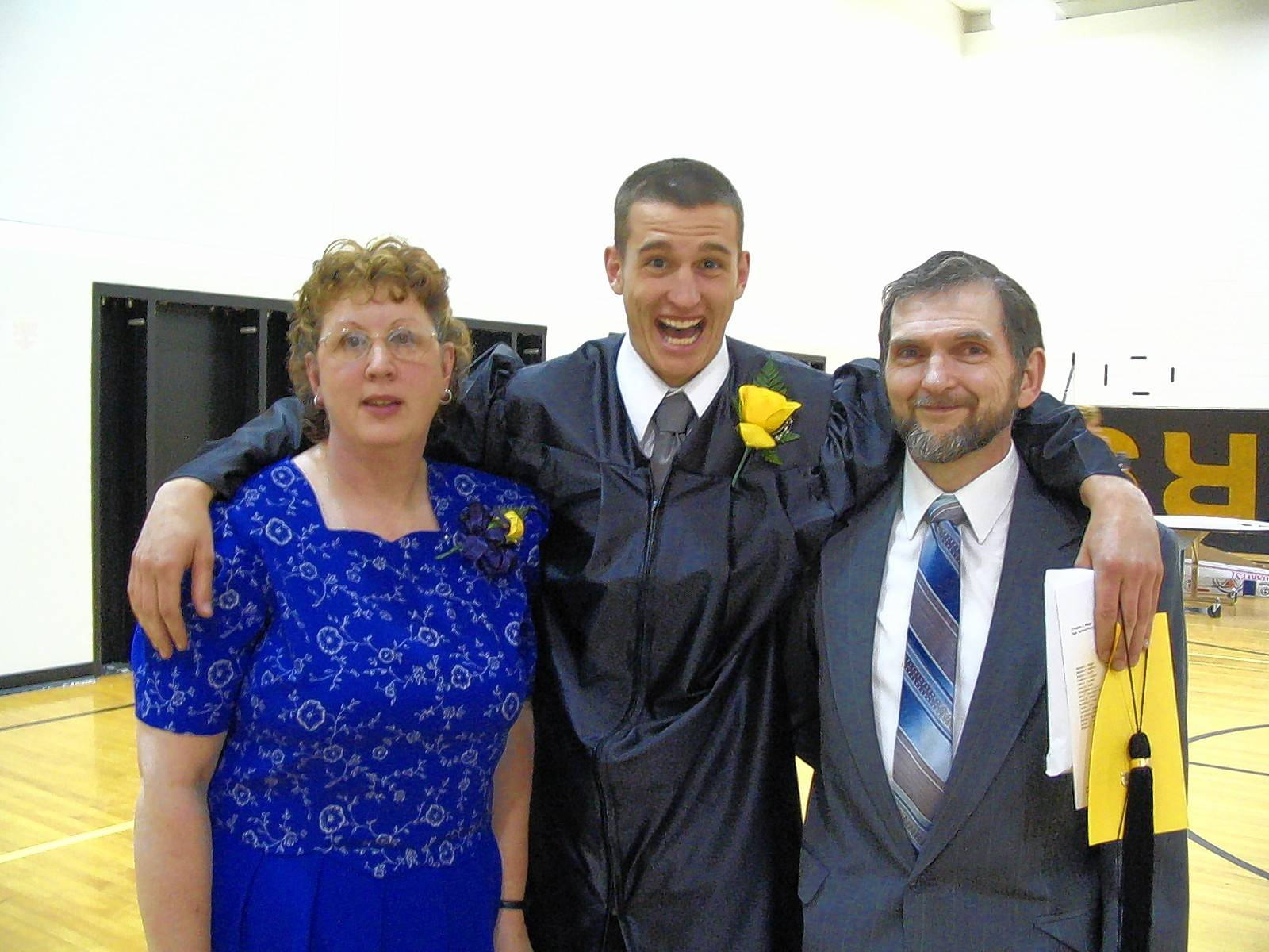 Ross A. McGinnis, center, at his high school graduation with his parents Romayne and Thomas McGinnis.