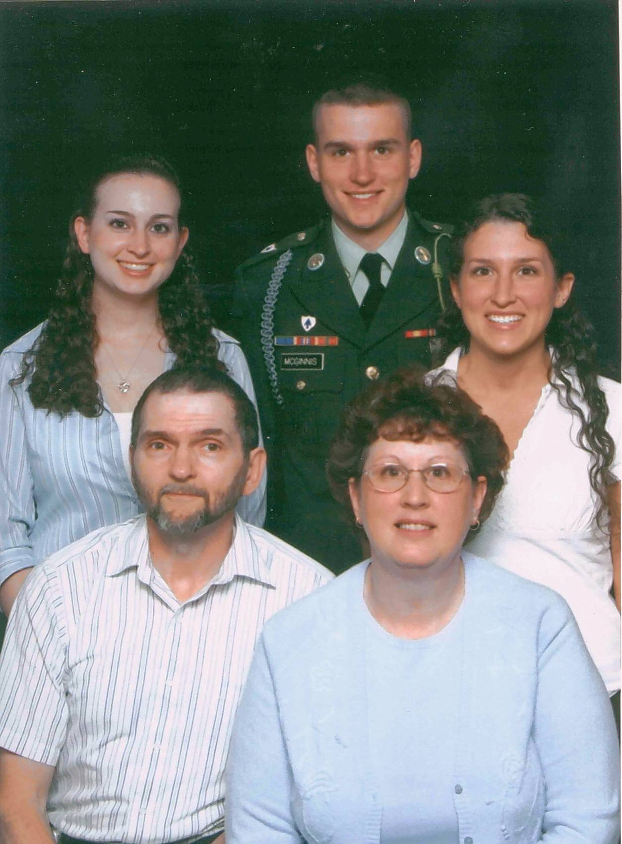 Ross A. McGinnis, center, with his sisters, Katie Orbison and Becky Gorman, and his parents, Tom and Romayne McGinnis.