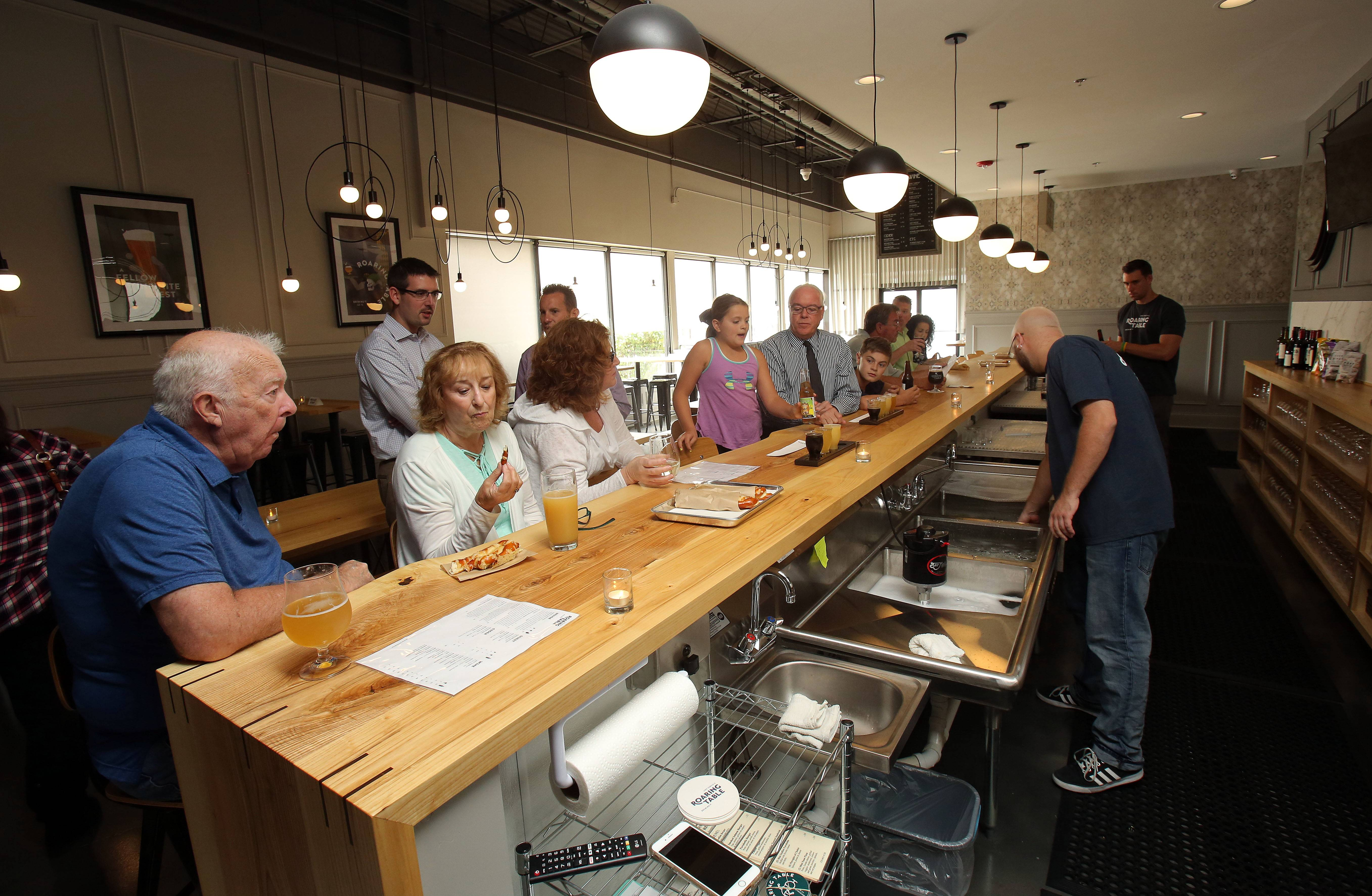 Roaring Table Brewery in Lake Zurich, which opens officially Friday, had a small ribbon-cutting event on Thursday.