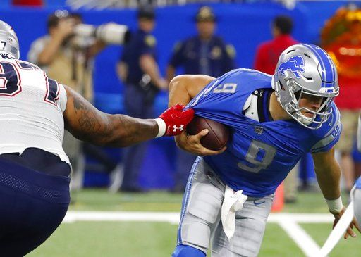 6f5f0c96a01 Detroit Lions quarterback Matthew Stafford (9) is sacked by New England  Patriots defensive end