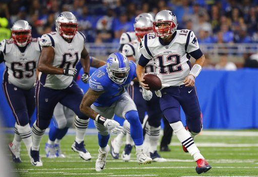 8602d6a431c New England Patriots quarterback Tom Brady (12) scrambles during the first  half of the