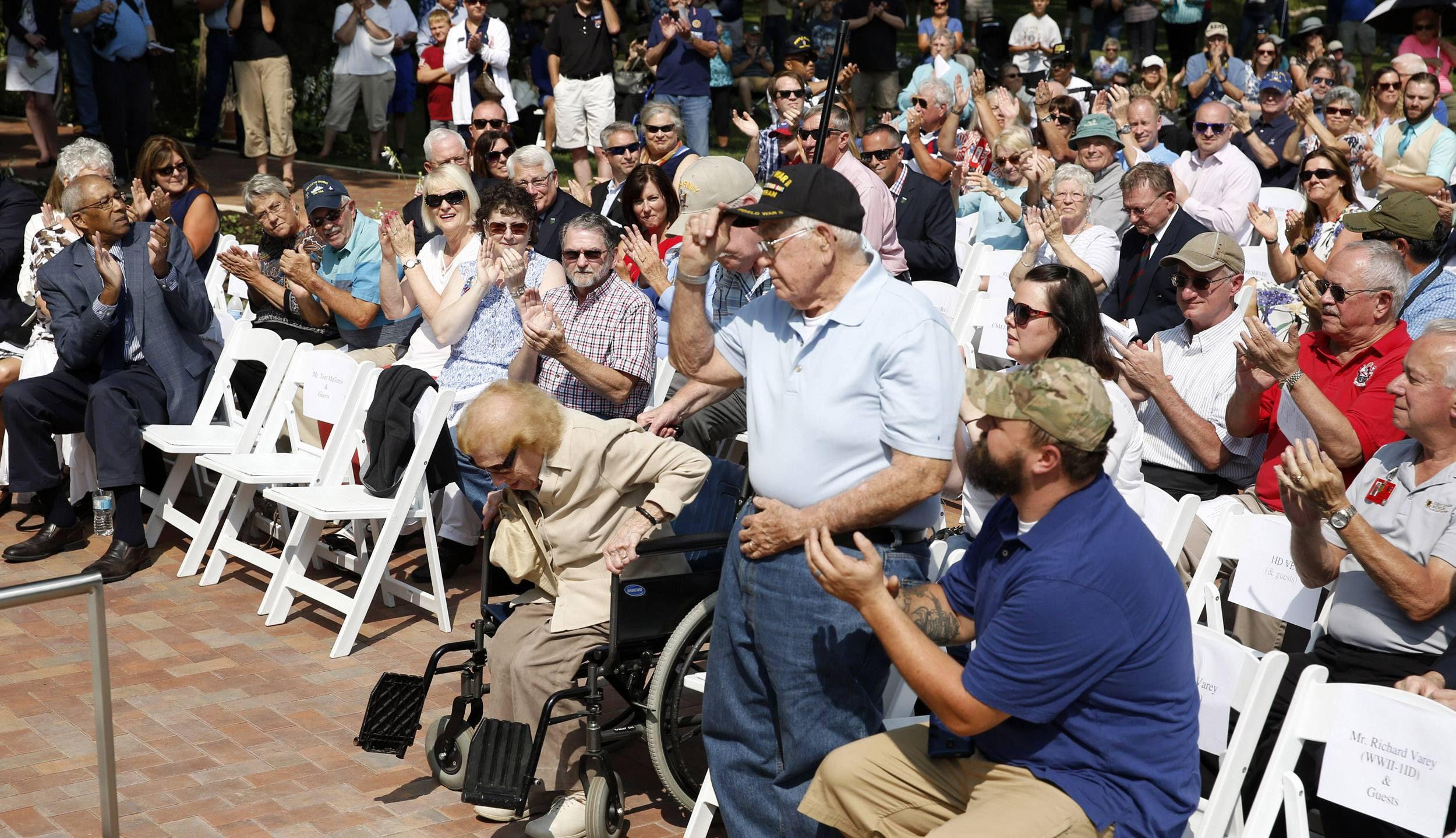 Richard Avery of Lisle, a World War II veteran who served in the Army's 1st Infantry Division, is recognized at a ceremony for the reopening of the First Division Museum at Cantigny Park in Wheaton.