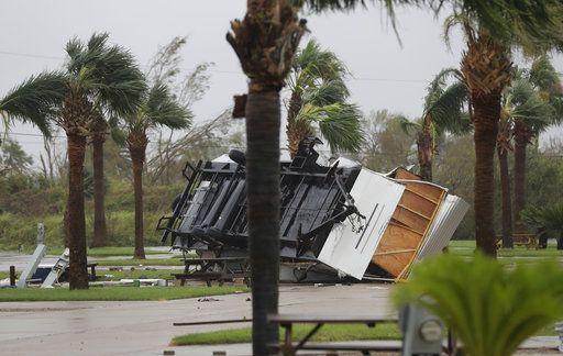The Latest: Houston roads start to flood as Harvey stalls