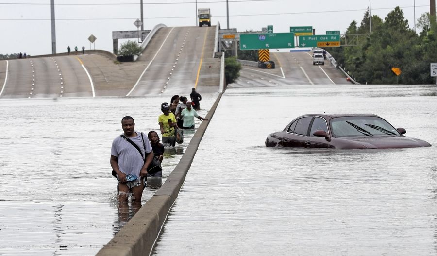 Emergency officials in Illinois and the suburbs say they're preparing to respond to any requests for assistance from storm-ravaged Texas, where evacuees waded down a flooded section of I-610 on Sunday.
