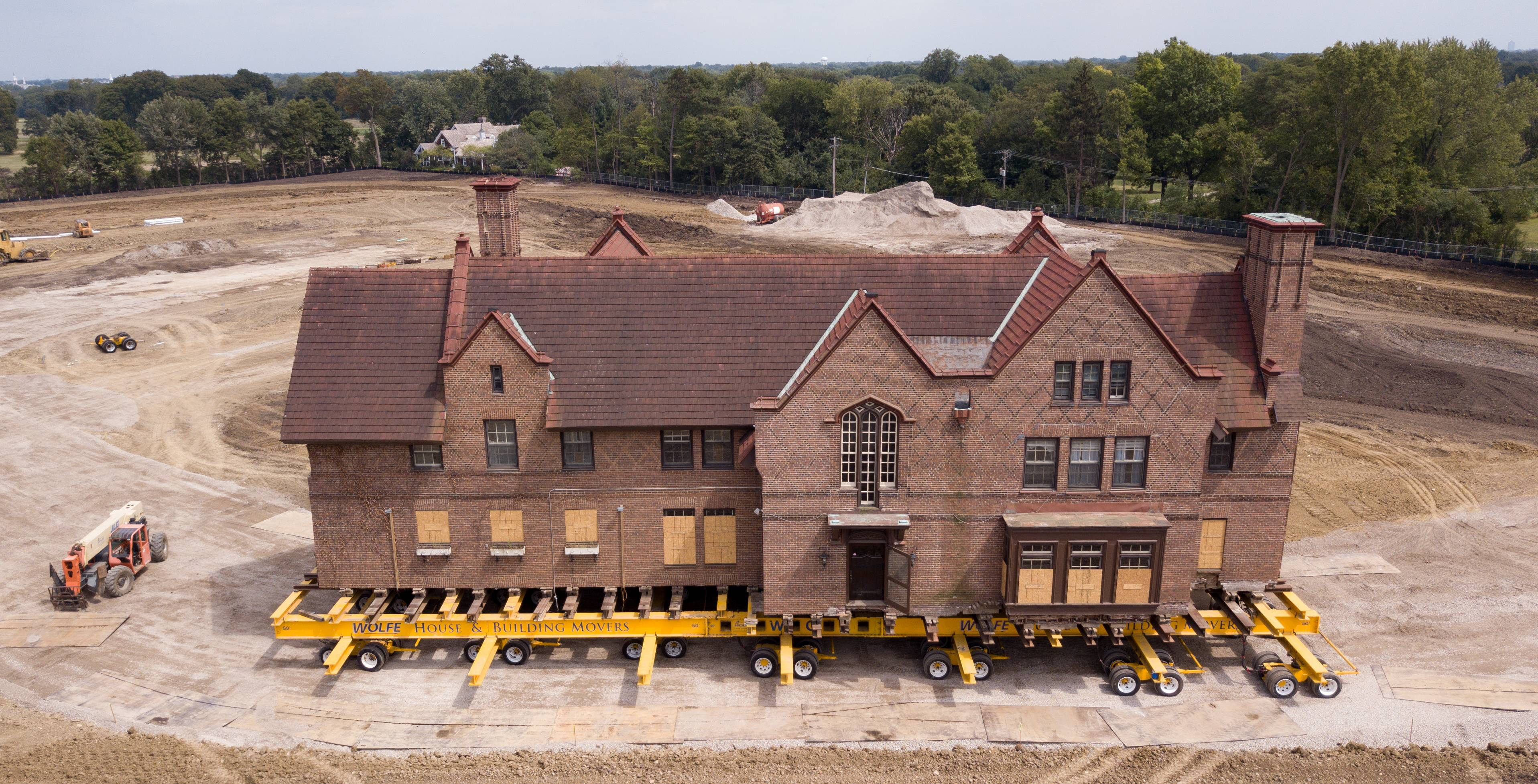Lifted onto dollies, 729-ton House of Seven Gables moved at a glacial pace down a gravel road installed by Pulte Homes, the company redeveloping the Loretto Convent campus.