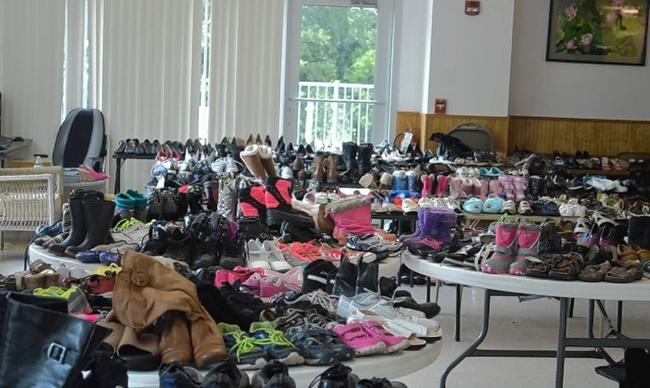 Donated shoes cover tables at the Antioch Senior Center, waiting for patrons of the Antioch Traveling Closet to take their pick.