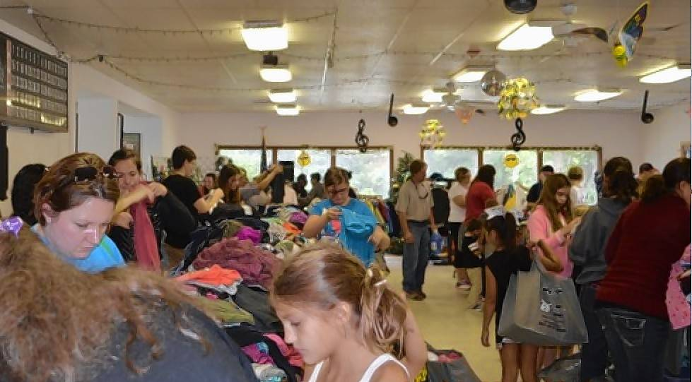 Families shop for needed items at a previous Antioch Traveling Closet event. The event on Aug. 20 served 340 people.