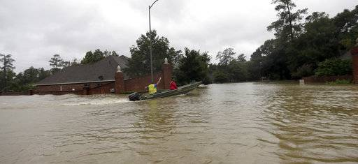 A rescue boat enters a flooded subdivision as floodwaters from Tropical Storm Harvey rise Monday, Aug. 28, 2017, in Spring, Texas.