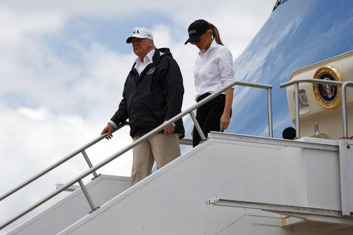 President Donald Trump and first lady Melania Trump arrive on Air Force One at Austin-Bergstrom International Airport in Austin, Texas, Tuesday, Aug. 29, 2017, wldfor briefings on Harvey relief efforts.