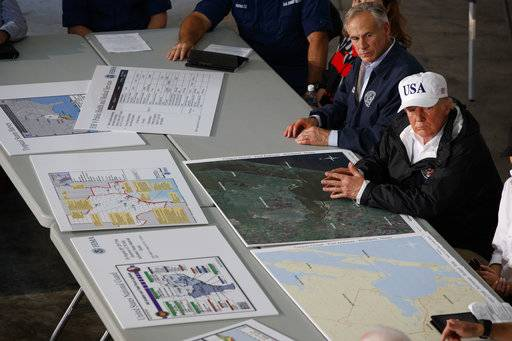 Texas Gov. Greg Abbot and President Donald Trump listen during a briefing on Harvey relief efforts, Tuesday, Aug. 29, 2017, in Corpus Christi, Texas.