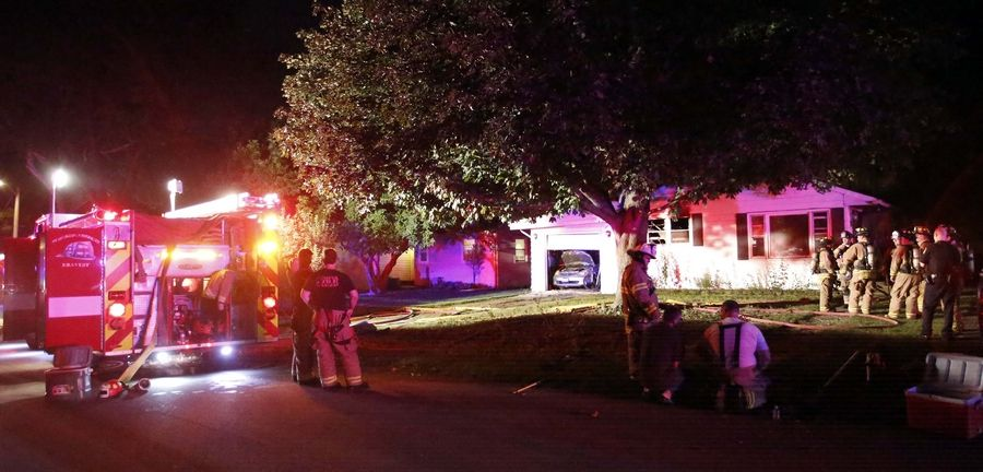Geneva firefighters and other area departments respond to a house fire in the 200 block of Kansas Street in Geneva Wednesday night.