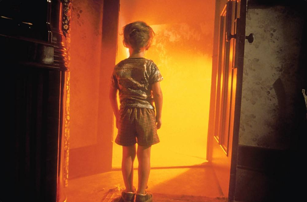 "Barry (Cary Guffey) opens the door for his extra-terrestrial neighbors in Steven Spielberg's 40th anniversary, 4K restoration of ""Close Encounters of the Third Kind."""