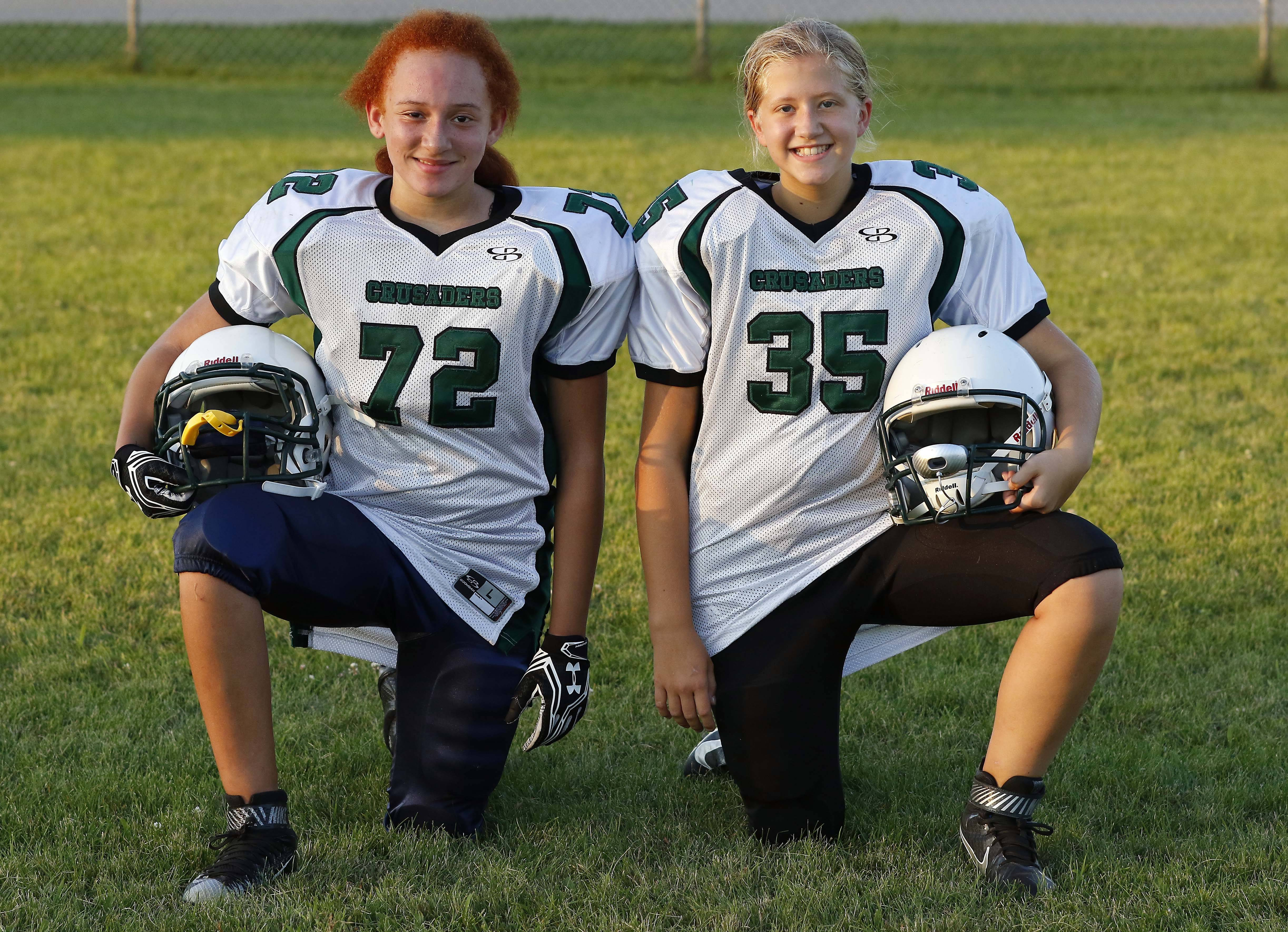 From left, Zoie Lewis and Sophia Olech, a sixth-grader at Haines Middle in St. Charles, are two of three girls playing alongside boys on the Elgin-based Crusaders middle school football team.