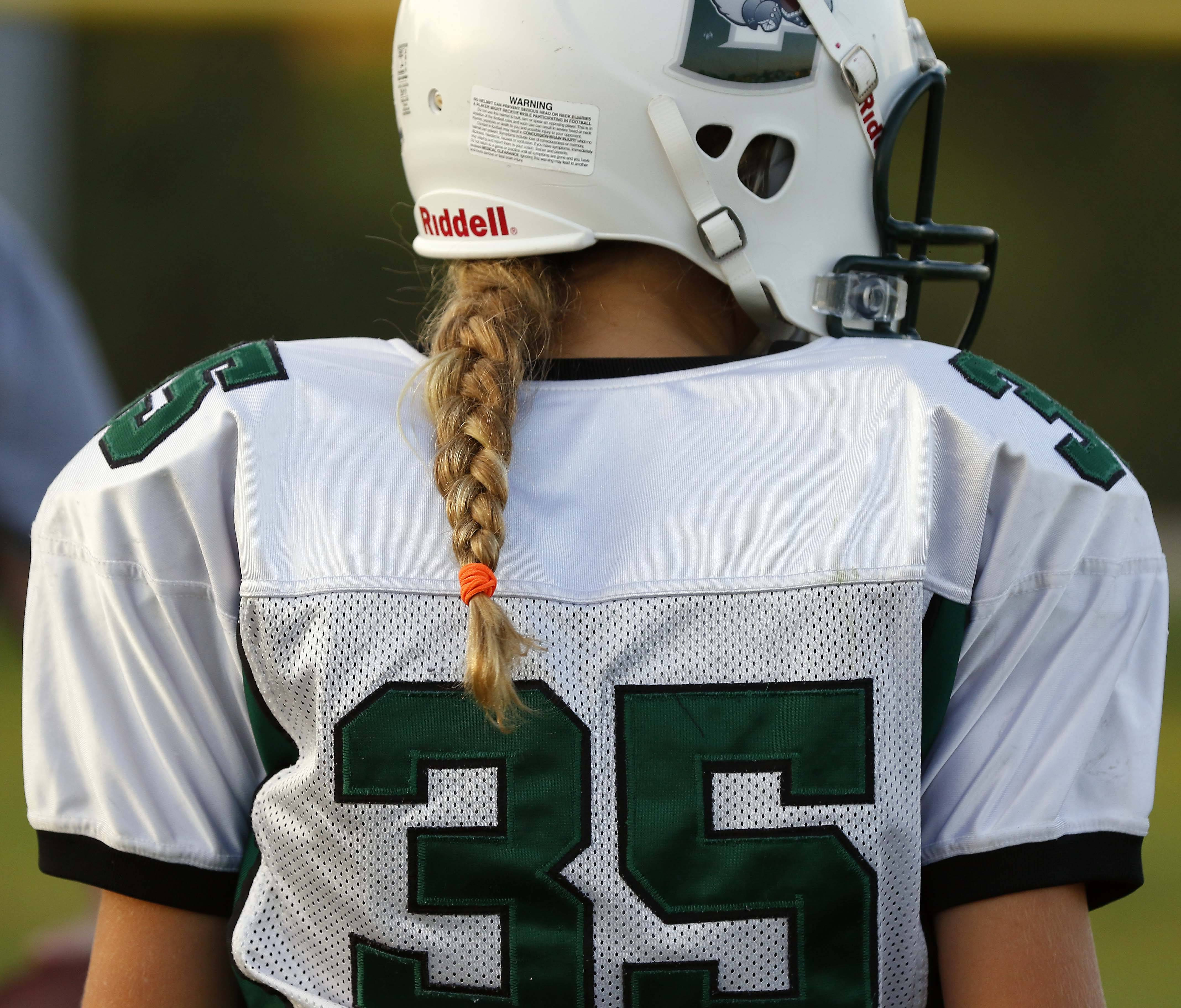 """They know they are playing against girls,"" football coach Joe Kenny said of the male players. ""They treat them like anybody else and they don't go easy on them."" Shown is Crusaders player Sophia Olech."