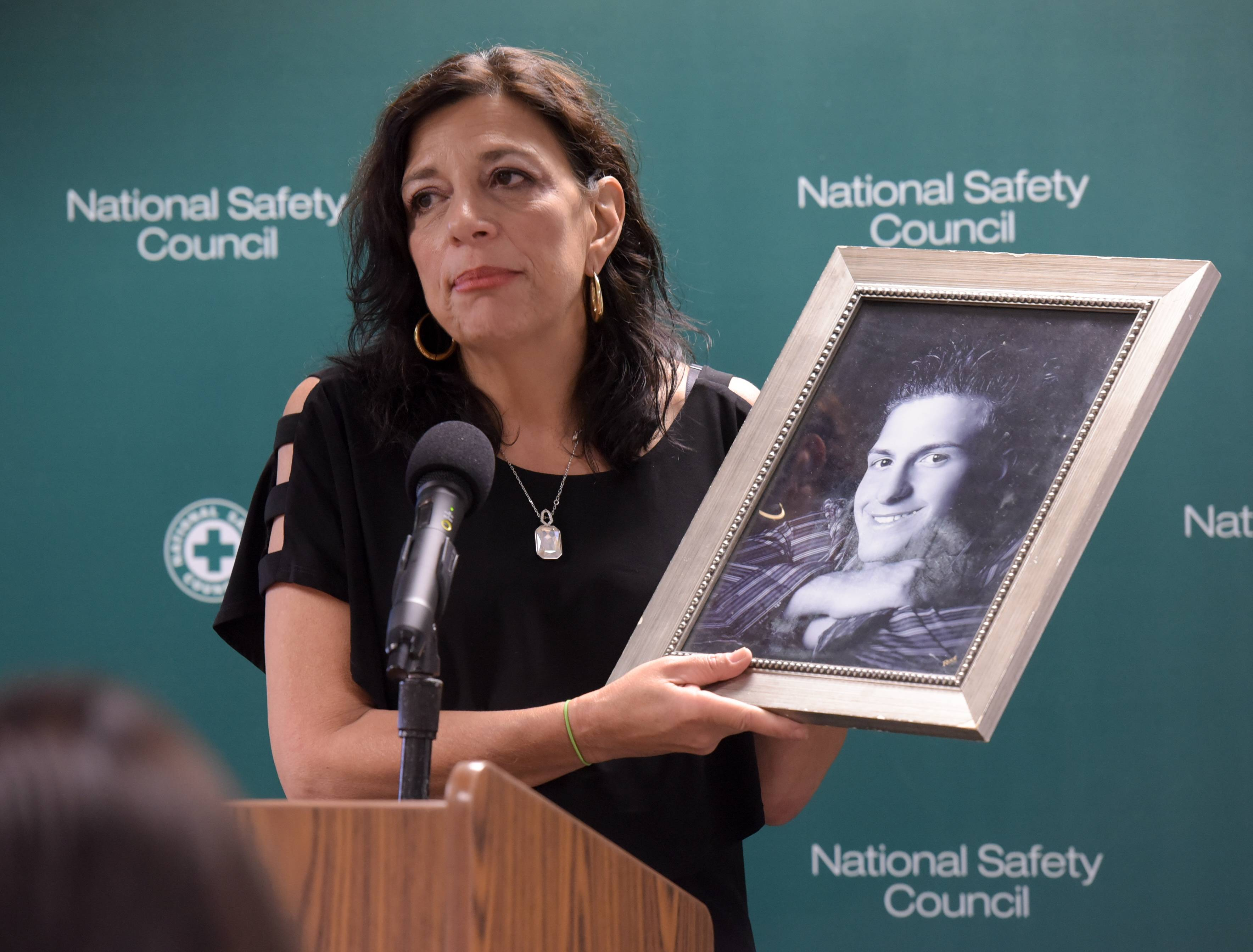 Mark Black/mblack@dailyherald.com Felicia Miceli of Medinah holds a photograph of her late son, Louie, who died of an overdose. She spoke during a Thursday news conference at the National Safety Council's headquarters in Itasca.