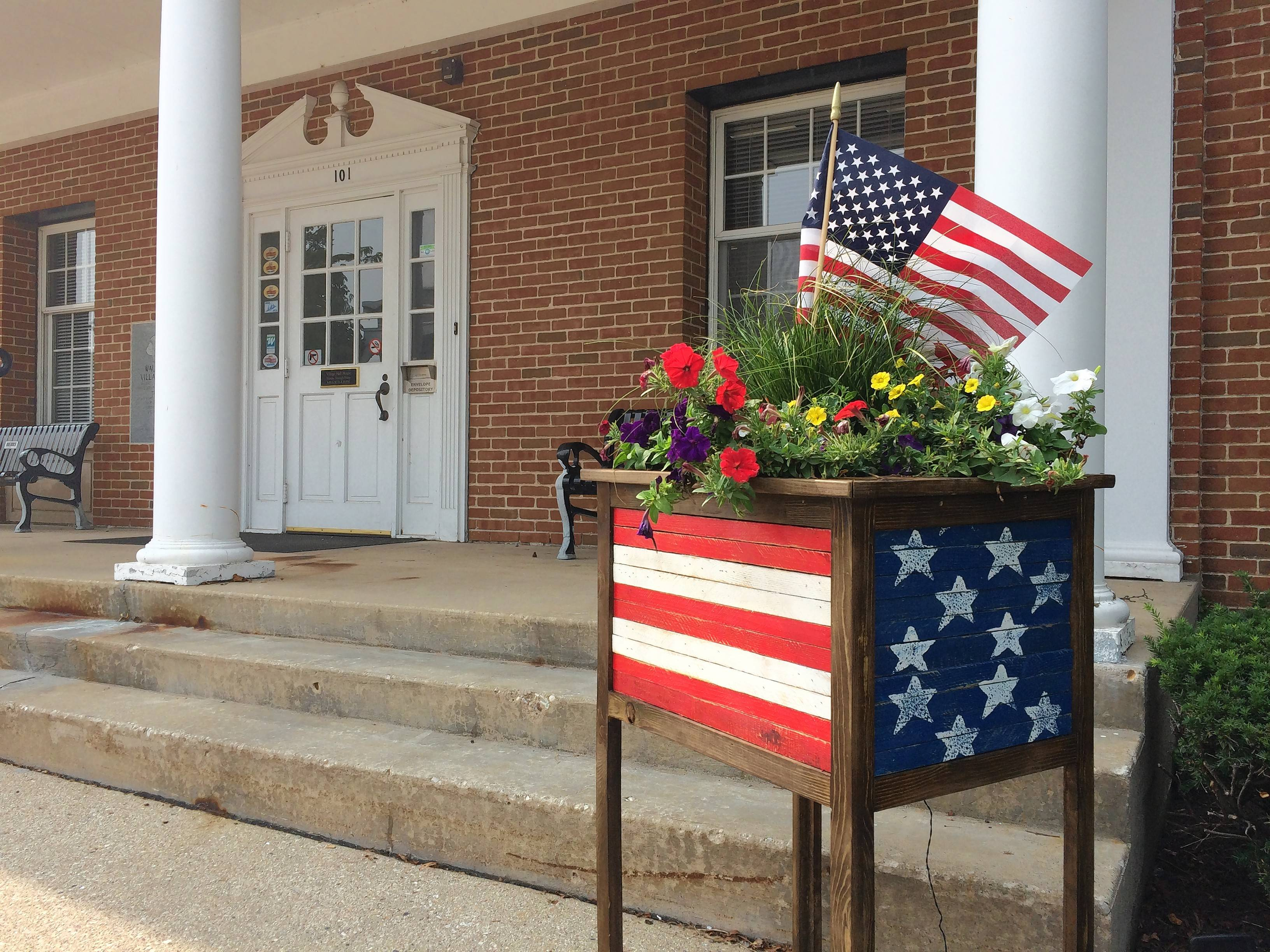 Fifteen planters decorate Main Street as part of an annual public art exhibition in Wauconda. The one in front of village hall has a U.S. flag motif.
