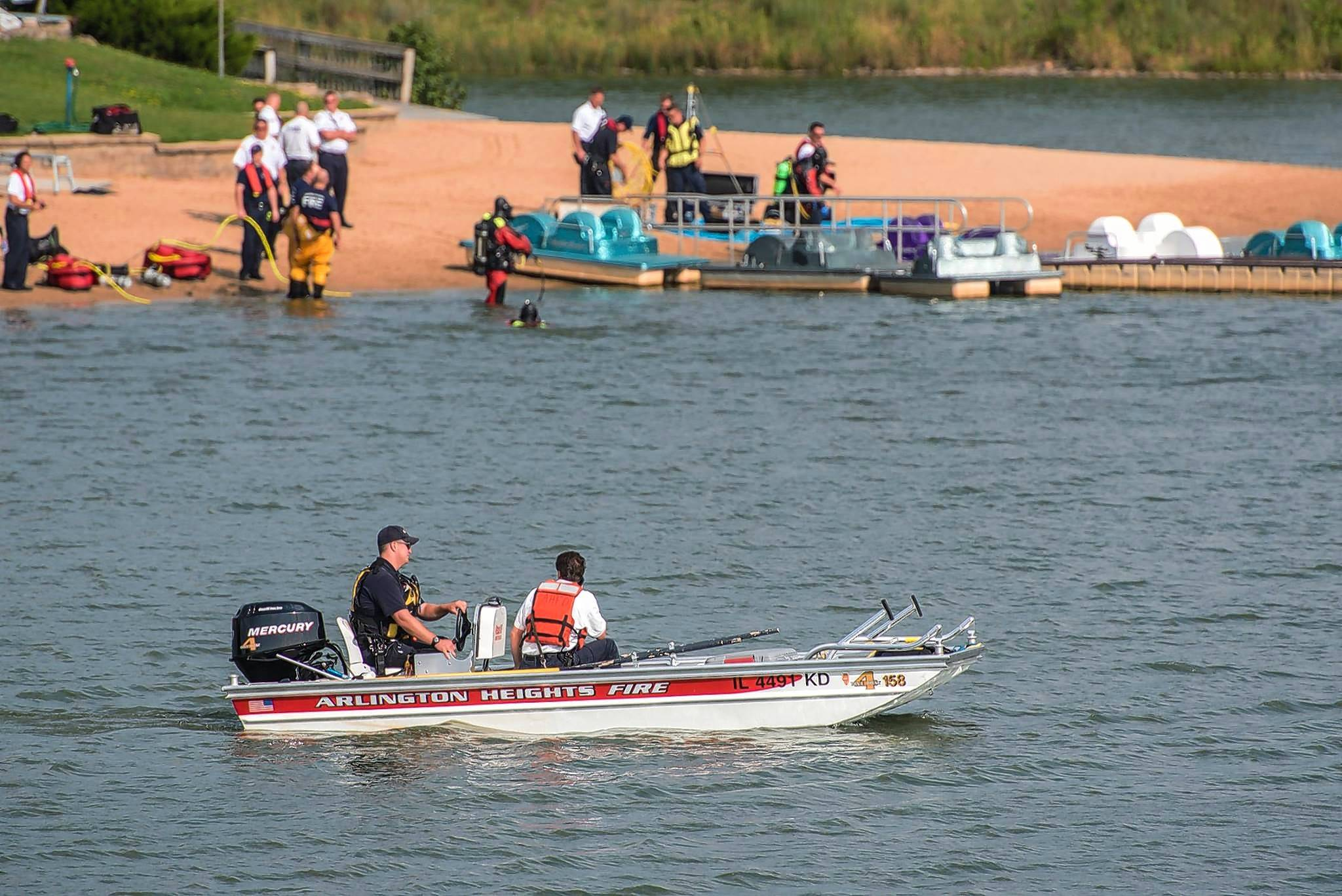 Police and fire departments search for a missing person in Lake Arlington Thursday. A 40-year-old woman was later rescued and taken to the hospital.
