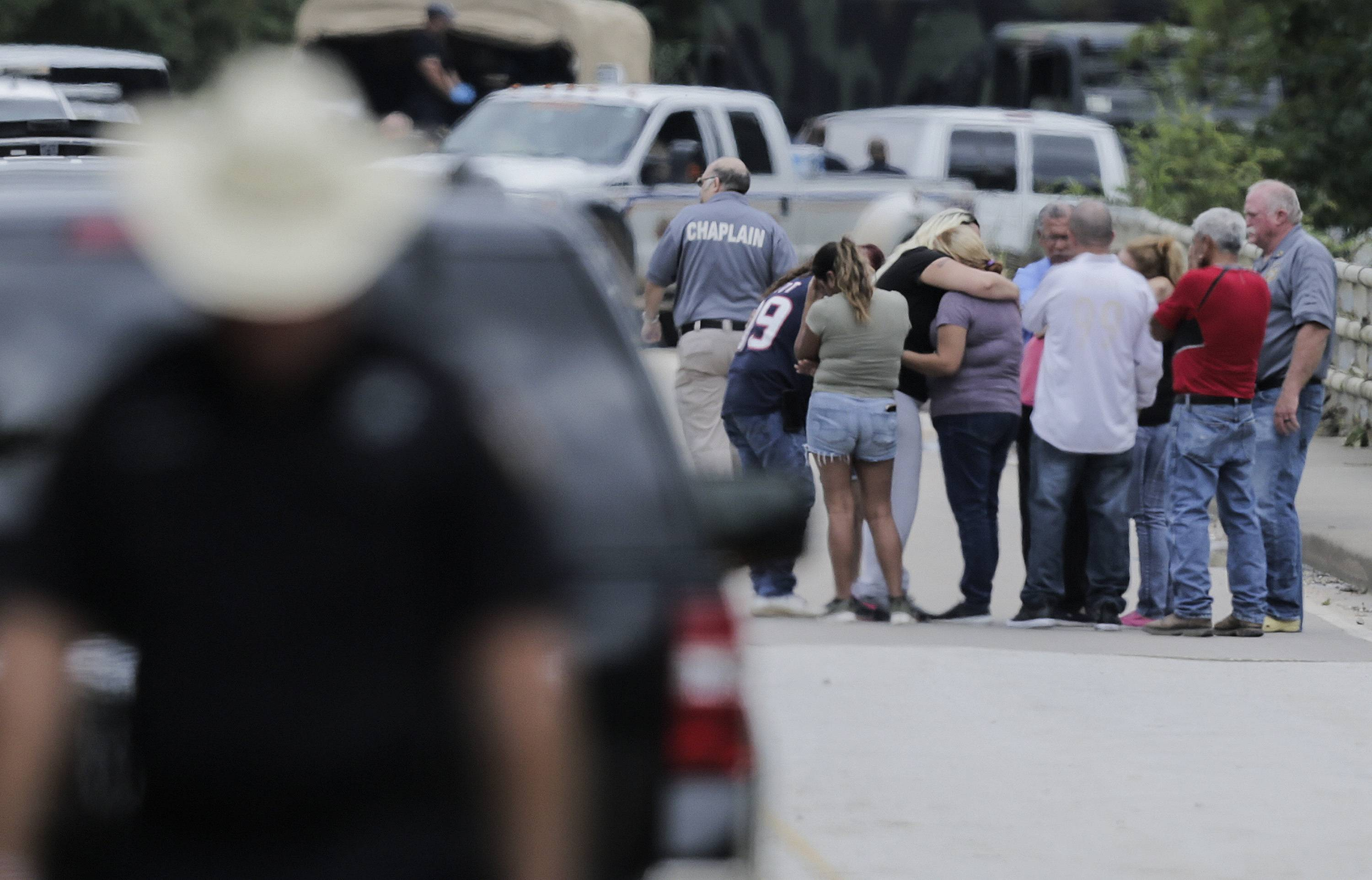 Family members react as a van is pulled out of the Greens Bayou with the bodies of six family members on Wednesday, Aug. 30, 2017, in Houston. The van was carried into the bayou during Tropical Storm Harvey as the water went over the bridge.