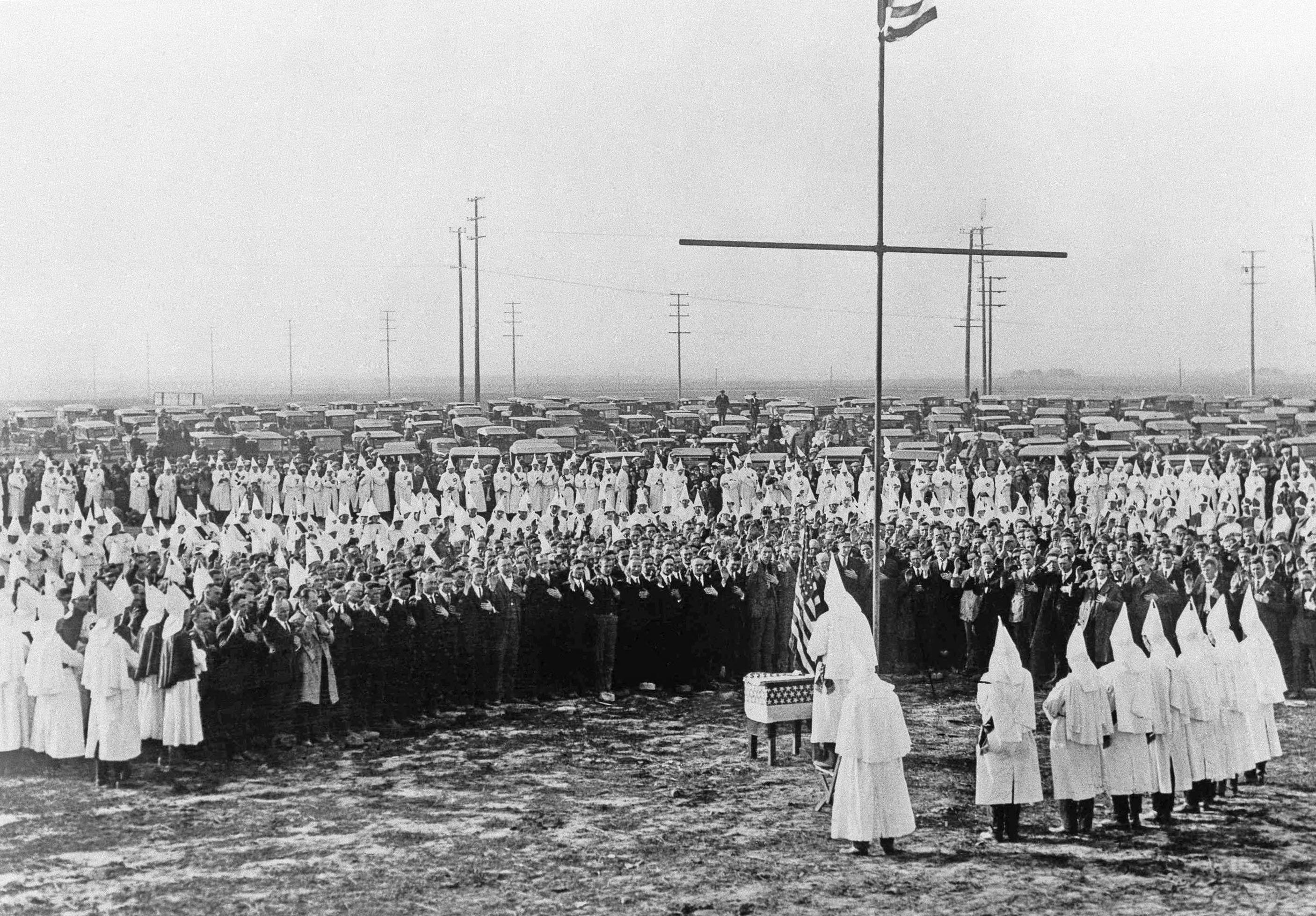 In this Feb. 13, 1925, file photo, Ku Klux Klan members hold a ceremonial meeting near Los Angeles.