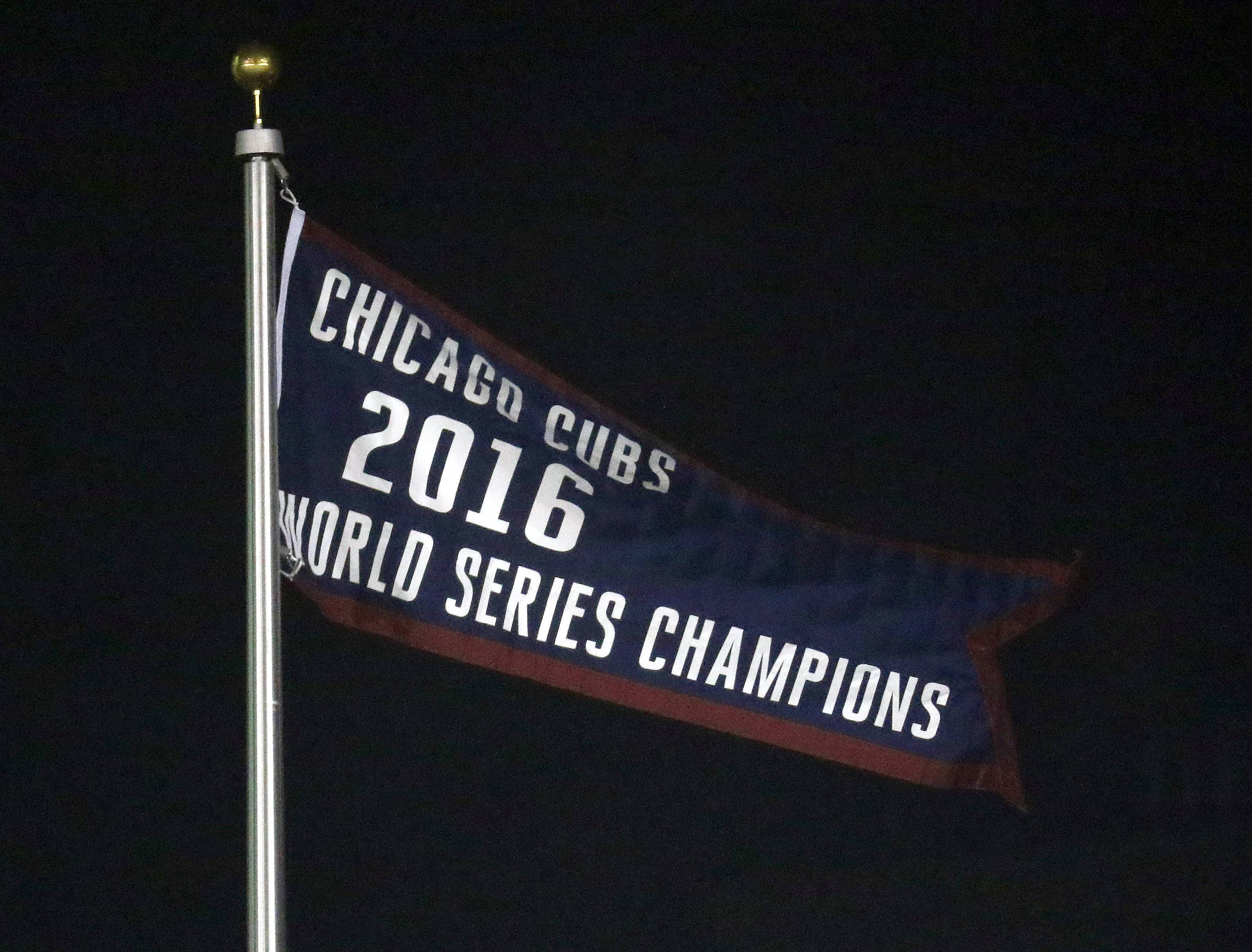 The 2016 World Series championship banner was raised before a night game at Wrigley Field on April 10, 2017. Now the Cubs will play their first Friday night game during the regular season at Wrigley thanks to an agreement with city officials.