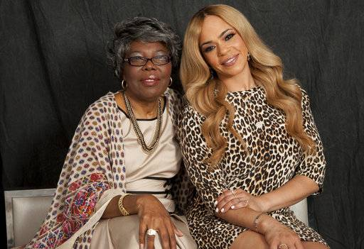 "In this Thursday, Aug. 17, 2017, photo, Voletta Wallace, left, and Faith Evans, right, pose for a portrait in New York. Wallace details the love for the Notorious B.I.G. as both his mother and No. 1 fan in the new, three-hour documentary, ""Biggie: The Life of Notorious B.I.G.� It debuts Monday, Sept. 4 at 8 p.m. EST on A&E. (Photo by Andy Kropa/Invision/AP)"