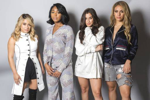 In this Aug. 24, 2017 photo, members of Fifth Harmony, from left, Ally Brooke, Normani Kordei, Lauren Jauregui and Dinah Jane pose for a portrait in Los Angeles to promote their self-titled album. (Photo by Willy Sanjuan/Invision/AP)