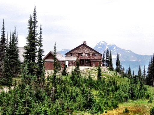 FILE- This 2014 file photo shows Granite Park Chalet towards on Heaven's Peak in Glacier Mational Park, Mont. The main building of an historic, backcountry chalet in Glacier National Park in northern Montana burned in a wildfire Thursday, Aug. 31, 2017. The two-story Sperry Chalet was lost despite efforts by firefighters to protect it and save it, fire officials said. (Erin Madison/The Great Falls Tribune via AP, File)