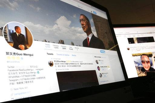 In this Wednesday, Aug. 30, 2017, photo, a Twitter page of Chinese exiles businessman Guo Wengui is seen on a computer screen in Beijing. Escalating efforts to repatriate one of its most wanted exiles, China's ruling Communist Party has opened a police investigation on a new allegation, rape, against New York-based billionaire Guo, who has been releasing what he calls official secrets ahead of a pivotal party leadership conference. (AP Photo/Andy Wong)