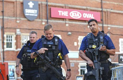 Police secure the area outside The Oval cricket ground in London, after play was suspended in the County Championship clash between Surrey and Middlesex after an arrow was fired onto the pitch, Thursday Aug. 31, 2017. An arrow was fired onto the field of play at The Oval cricket stadium, and London's Metropolitan Police said there are no reported injuries and that no arrests had been made. (Jonathan Brady/PA via AP)