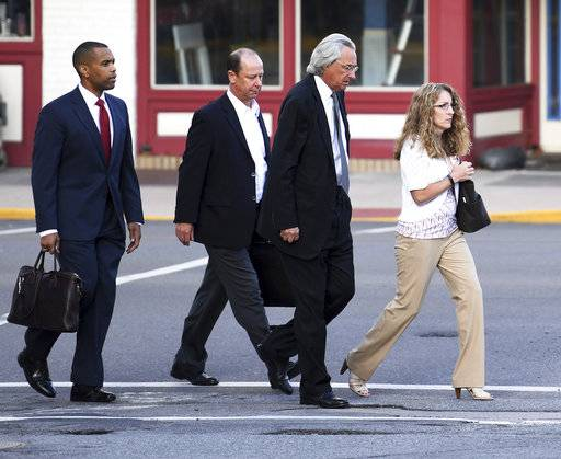 From right, Evelyn Piazza, attorney Tom Kline and Jim Piazza and walk toward the courthouse before a preliminary hearing resumes for members of a fraternity facing criminal charges over the death of Timothy Piazza, at the Centre County Courthouse in Bellefonte, Pa. Piazza, a 19-year-old sophomore, suffered severe head and abdominal injuries last February, after consuming a dangerous amount of alcohol and fell repeatedly. Help wasn't summoned until the next morning, and he later died at a hospital. (Phoebe Sheehan/Centre Daily Times via AP)