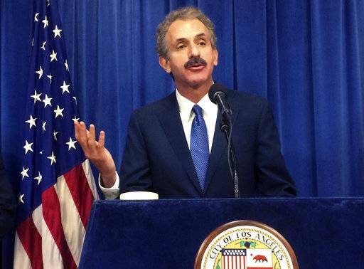 FILE - In this Tuesday, June 20, 2017, file photo Los Angeles City Attorney Mike Feuer talks during a news conference in Los Angeles. Motel 6 has agreed to pay $250,000 to settle a lawsuit brought by Los Angeles that alleged one of the chain's locations was a base for human traffickers, drug dealers and gang members, prosecutors said. Feuer told The Associated Press on Wednesday, Aug. 30, 2017, that the money will be used to help deter human trafficking. (AP Photo/Christopher Weber, File)