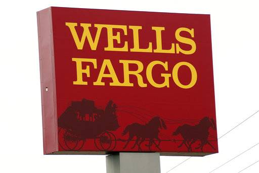 FILE - This April 11, 2017, photo shows a Wells Fargo bank in northeast Jackson, Miss. Wells Fargo said Thursday, Aug. 31, 2017, that 3.5 million customers were impacted by its fake accounts scandal, a dramatic increase from the 2.1 million accounts it originally estimated. (AP Photo/Rogelio V. Solis, File)