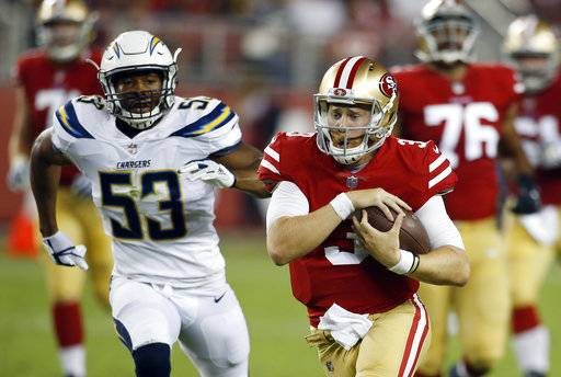 San Francisco 49ers quarterback C.J. Beathard, right, runs for a touchdown against the Los Angeles Chargers during the first half of a preseason NFL football game Thursday, Aug. 31, 2017, in Santa Clara, Calif. (AP Photo/D. Ross Cameron)