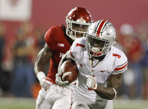 Ohio State wide receiver Johnnie Dixon runs past Indiana defensive back Jonathan Crawford for a 59-yard touchdown reception during the second half of an NCAA college football game Thursday, Aug. 31, 2017, in Bloomington, Ind. (AP Photo/Darron Cummings)
