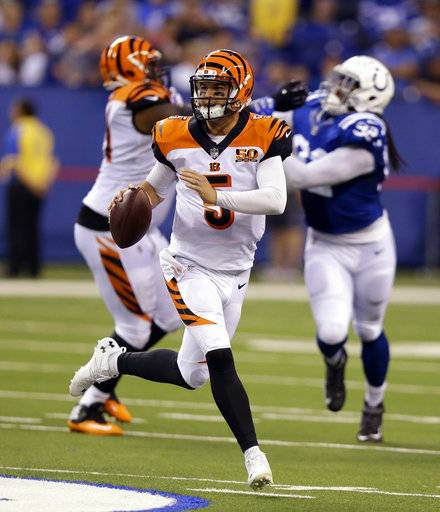 Cincinnati Bengals quarterback AJ McCarron (5) scrambles during the first half of a preseason NFL football game against the Indianapolis Colts in Indianapolis, Thursday, Aug. 31, 2017. (AP Photo/Michael Conroy)