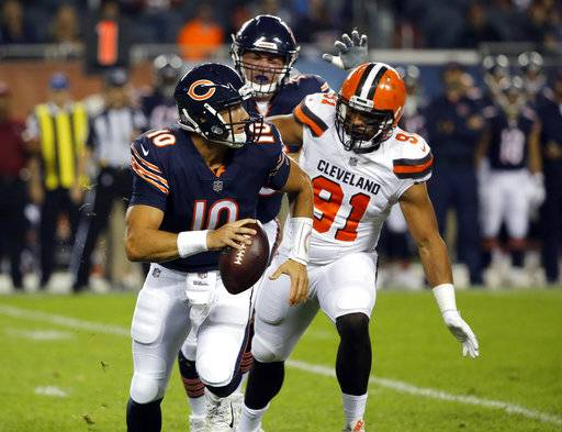Chicago Bears quarterback Mitchell Trubisky (10) runs against Cleveland Browns defensive end Tyrone Holmes (91) during the first half of an NFL preseason football game, Thursday, Aug. 31, 2017, in Chicago. (AP Photo/Charles Rex Arbogast)